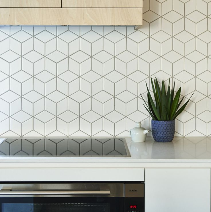 9 Ideas For Backsplash Materials You Can Install In Your Kitchen- Designed by Altereco Design. Photography by Nikole Ramsay.