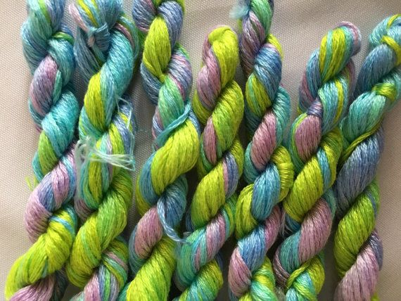 This is my hand dyed thread in the colourway Beach Towel on 8m Anchor six stranded floss for cross stitch or embroidery, or other needlework.