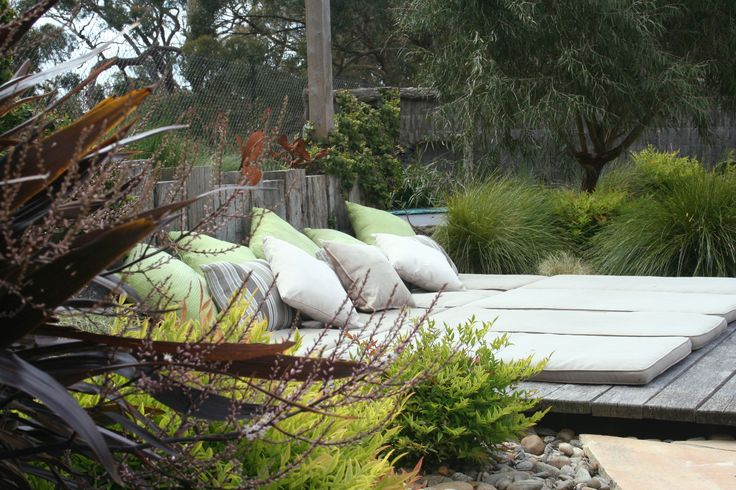 A rustic day bed set into a bush garden. www.rpgardendesign.com.au