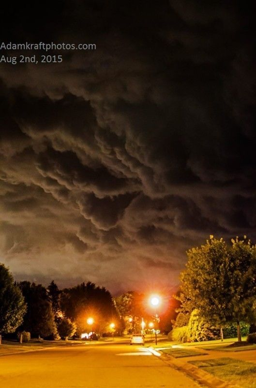 """Top 10 Weather Photographs: 8/6/2015 """"Ominous Storm Makes Its Way Down a Michigan Street"""" – Combo of a F/1.8 lens and city lights made this ominous storm pic possible as outflow raced in ahead of storms Sunday night August 2nd. Taken in Spring Arbor."""