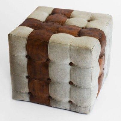 Rustikk puff i grå kanvas med brunt skinn. Til salgs i vår nettbutikk www.bodesign.no