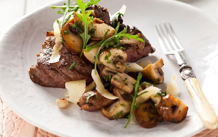 Seared pepper and lemon crusted Ostrich fillet with sautéed wild mushrooms. Ostrich meat tastes very similar to beef. #recipe #ostrich #fillet #mushrooms