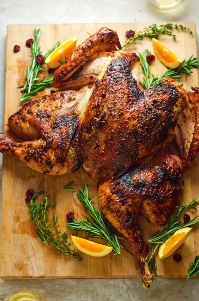 Crispy Cranberry-Herb Butter Butterflied Turkey with Roasted Vegetables. Want flavorful turkey with ultra-crisp skin and juicy meat? Want it faster than your traditional Thanksgiving bird? WITH roasted veggies? Well, here you go.   hostthetoast.com