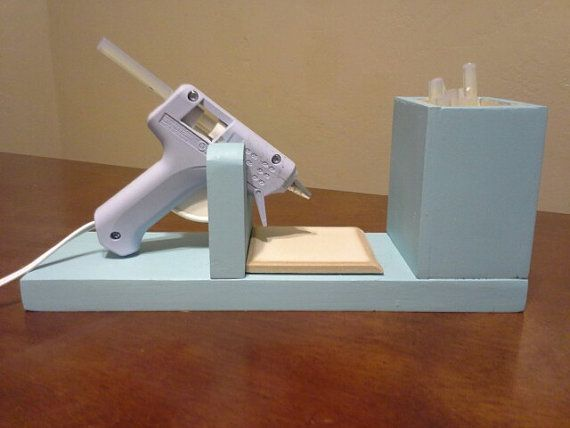 This glue gun holder makes it easy to use your glue gun and not get melted glue all over.