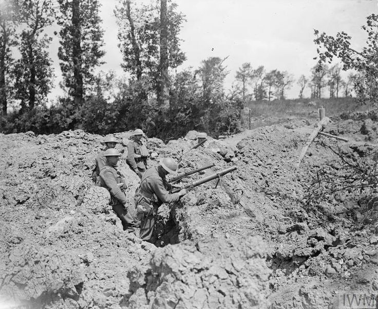 Royal Scots shown using a hastily dug position in a mine crater during the German Spring Offensive, 23 June, 1918, near Meteren.