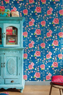 I really like that wallpaper! and cabinet!