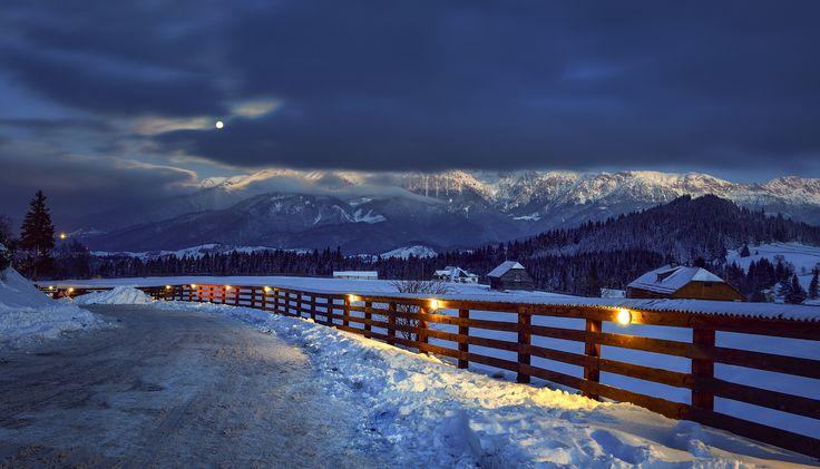 Winter night in Transylvania - Moieciu is a commune in Braşov County, Romania…