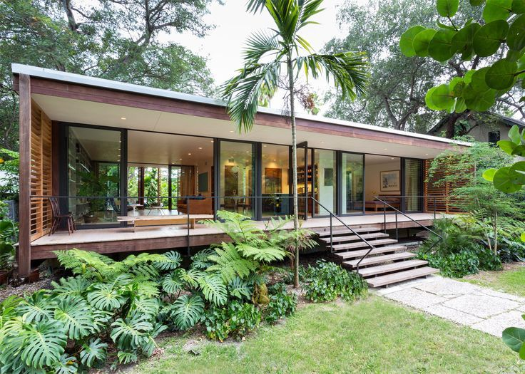 Florida-based studio Brillhart Architecture has completed a home fronted by slatted wooden shutters in a lush Miami forest.