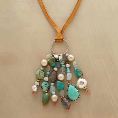 """turquoise tassel necklace  A kinetic assemblage of turquoise, labradorite, aquamarine, blue chalcedony and cultured pearls dangling from supple deersuede. Handcrafted exclusive. Sliding bead adjusts length to 36""""L."""