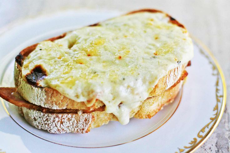 Class French Croque Monsieur! toasted ham and Swiss cheese sandwich, topped with a bechamel sauce  of butter, flour, milk, nutmeg, Parmesan and Gruyere.