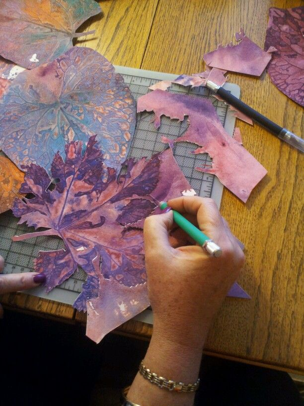 Cutting a painted leaf for collage ColoursBySheri.com