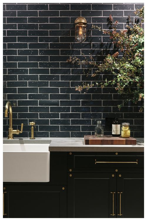 dark tiled backsplash