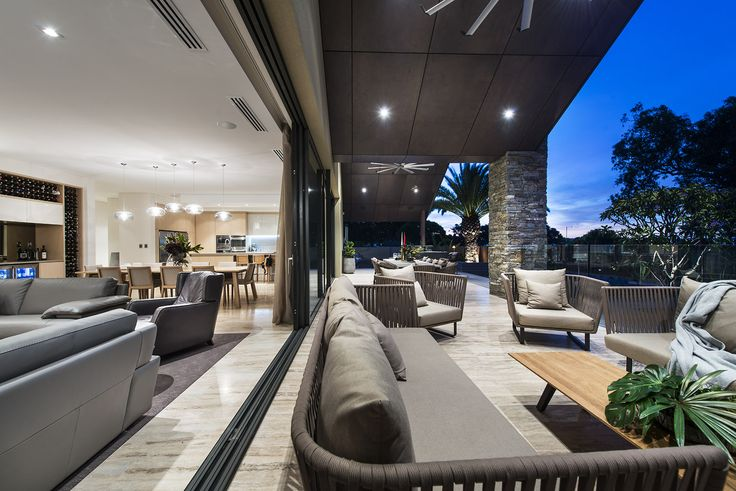 Large sliders open this home for effortless integration of indoor & outdoor living.  Home designed and built by Urbane Projects, Perth