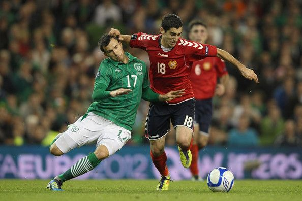 Keith Fahey (L) of Republic of Ireland challenges Henrikh Mkhitaryan (R) of Armenia during the EURO 2012 Group B qualifying match between the Republic of Ireland and Armenia at the Aviva Stadium on October 11, 2011 in Dublin, Ireland. - Republic of Ireland v Armenia - EURO 2012 Qualifier