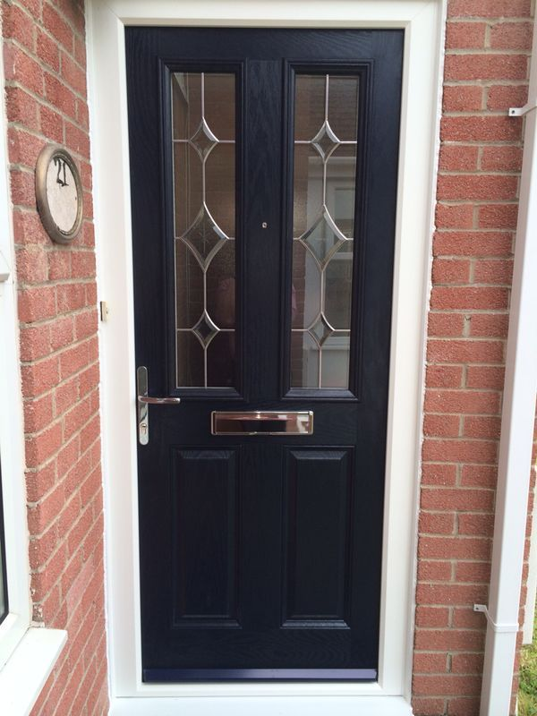composite front door in navy blue with bevelled glass perfectly the red brick walls