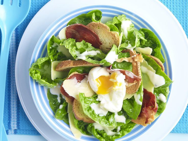 A Caesar salad with crunchy croutons, prosciutto and poached eggs.