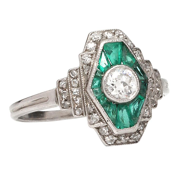 1930s Diamonds and Emeralds Platinum Ring | From a unique collection of vintage more rings at https://www.1stdibs.com/jewelry/rings/more-rings/