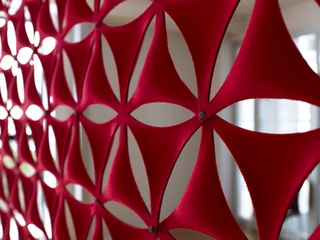 Urban Kinetics: Airflake  Airflake is a sound absorber which can hang on the wall, from the ceiling or used as a room divider. It offers almost endless possibilities for building your own pattern. Made from moulded polyester fibre, with laminated textile.