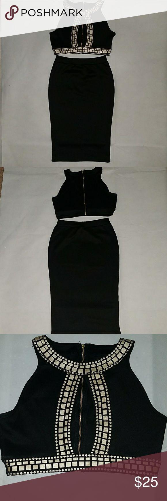 NWOT 2 PIECE GOLD TRIBAL SHIRT & BLACK SKIRT SET NWOT 2 PIECE SHIRT AND SKIRT SET GOLD TRIBAL SHIRT & BLACK SKIRT GOLD ZIPPER IN THE BACK OF SHIRT Skirts Skirt Sets