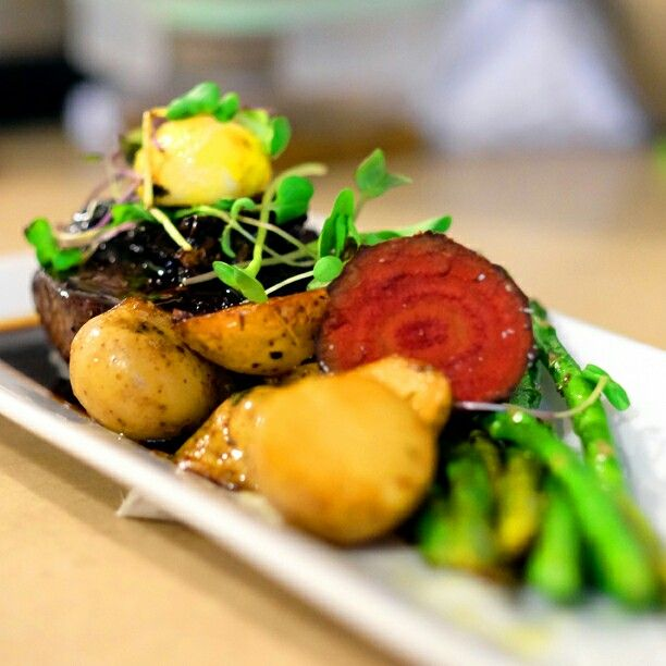 Balsamic/Maple syrup shallots, tenderloin,  sous vide egg yolk, pomme fondant,  asparagus with beet chips.