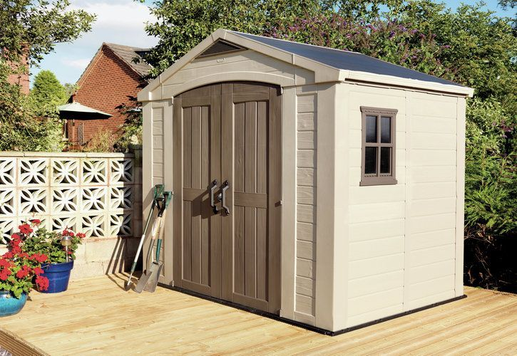 Backyard With Low Deck And Plastic Shed : The Benefits Of Plastic Sheds