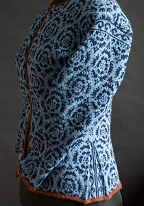 Feral Knitter - The pleat and contrast colour really gives this cardigan a point of difference and gives it a dressed up quality.  If you click thru the pic, it will take you thru to the teachers blog site.  Lucky those people who live in the Seattle area  :-)  and could attend her classes!