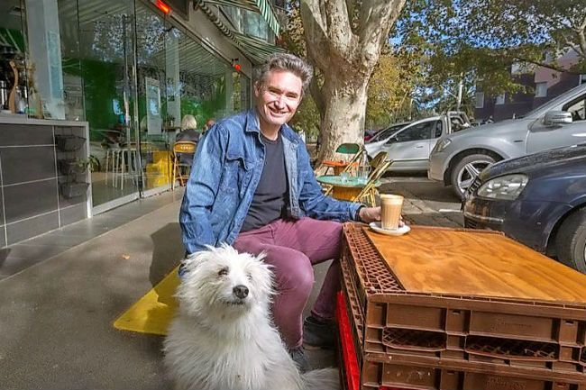 I love St Kilda: Dave Hughes. Where do you go for time to yourself?  That often includes the dog, Barkly. I grab a coffee and walk to the Peanut Farm oval or St Kilda dog beach and watch Barkly have fun.  Photo: Scott McNaughton