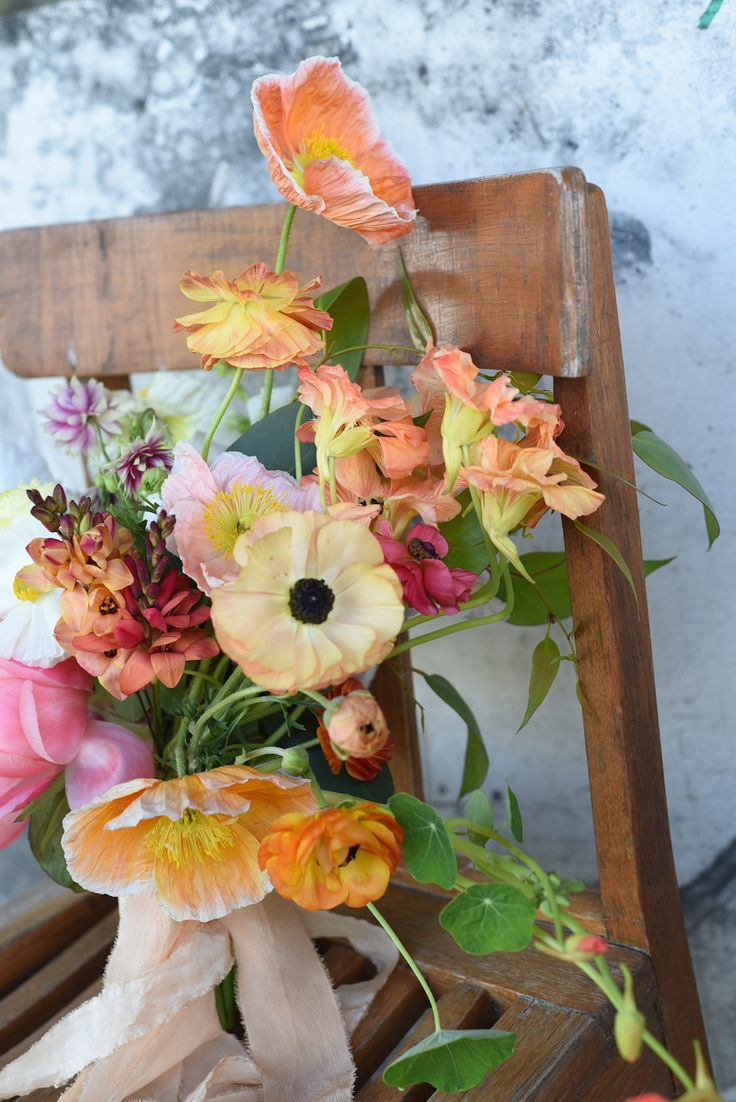 october flowers, bridal bouquet, spring flowers, coral peony, poppies, ranunculus, nasturtium, bearded iris, sherbet tones, orange, creamy yellow, white, ivory, spring wedding