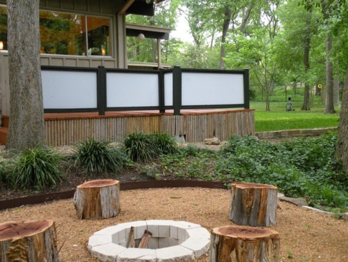 Easy, DIY stacked block firepit with tree trunk seats...