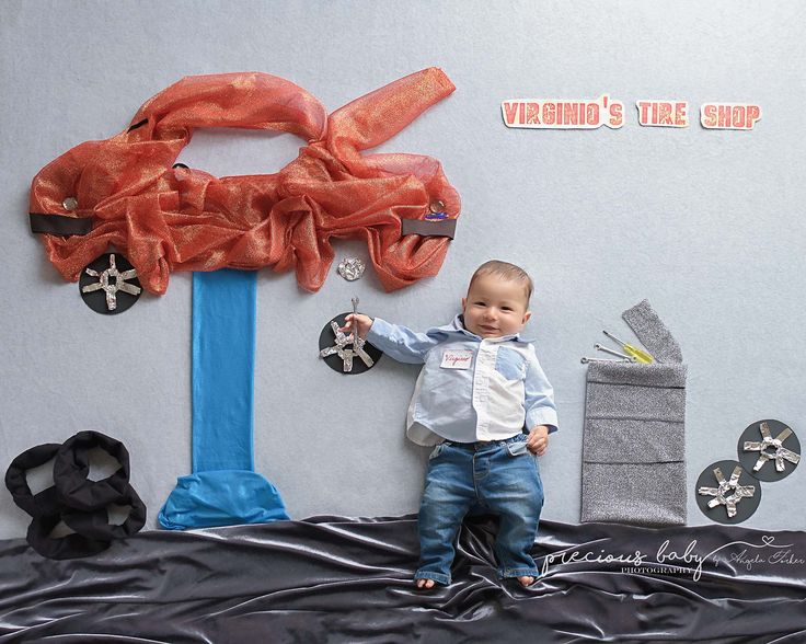 Newborn baby boy with a tire shop. Car tires wheels Funny creative  hilarious Floor art unique Baby scenes Baby ImaginArt by Angela Forker Precious Baby Photography Fort Wayne New Haven Indiana