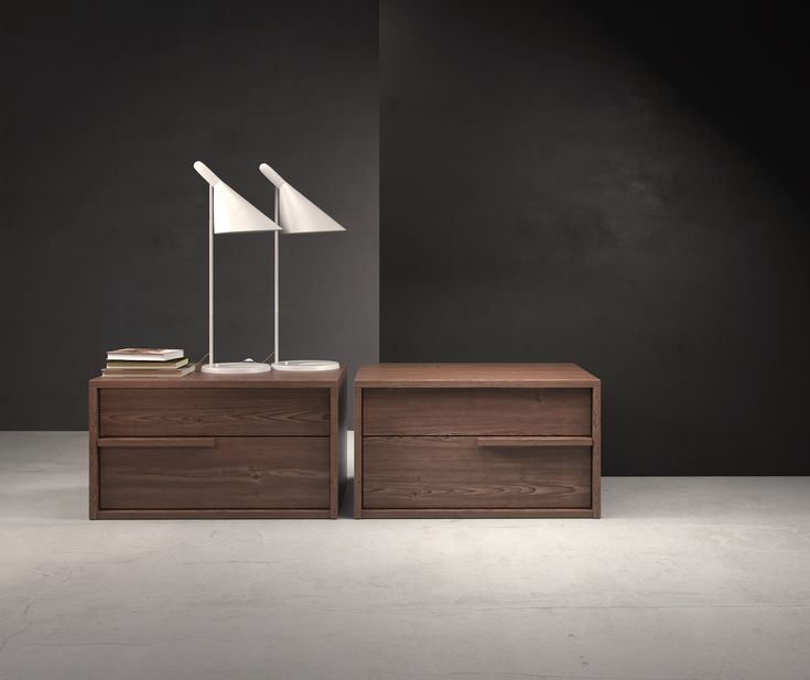 The Jane double-drawer nightstand features a sleek design accentuated by thin handgrips. Italian Danco-brand soft-closing hardware enables smooth and effortless drawer movement. Left and right handle orientation options. Interior of drawers elegantly lined in light beige linenboard.