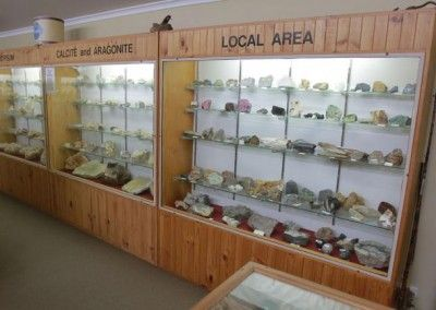 NUNDLE Tourist Info Centre The Gil Bennet Gem and Mineral Collection is the work of Tamworth local, the late Gilmore (Gil) Thomas Bennett who spent years collecting the unique and wondrous selection of fine stone and rock.