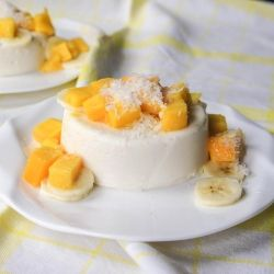 A panna cotta, lightened up with yogurt, and topped with tropical fruit and coconut. A perfect light summer treat!
