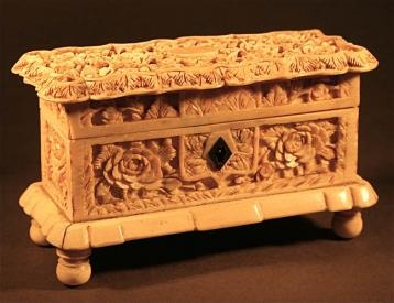 The sides of the ivory box are hand carved and decorated with an attractive flower and leaf design, and the interior is a red antique felt textile. This whimsical box was designed to lockup some ones loving keepsakes.