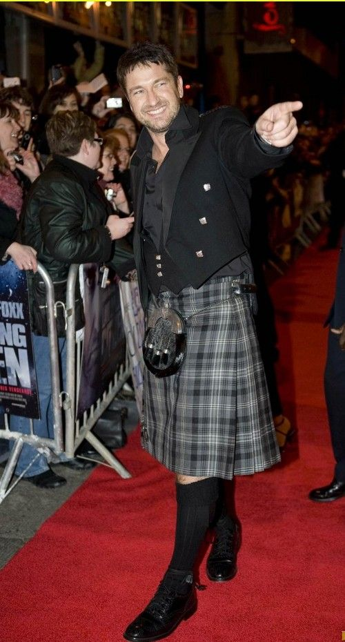 There are actually 20 men rocking kilts on this particular article, but Gerard out rocks them all.