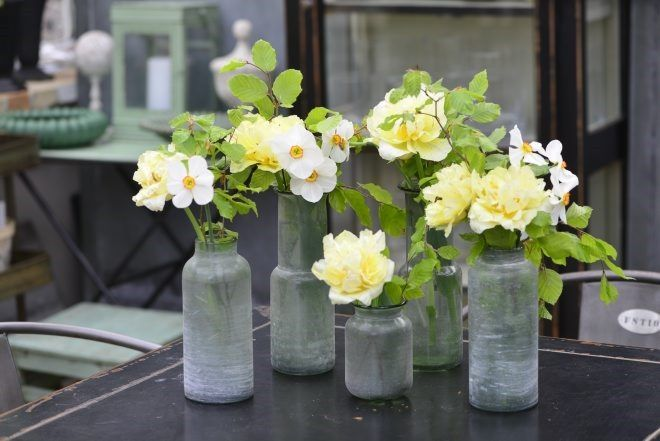 Love using antique bottles to hold flowers or to start a cutting to root.