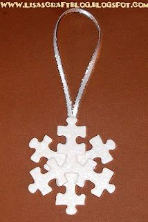 For this snowflake version, I glued 3 puzzle pieces evenly spaced from one another onto a grey-board circle. On top, I added another 3 puzzle pieces centered between them, which formed the perfect snowflake! I painted the snowflake with Gesso and added glitter glue. Then I attached the ribbon hanger and was finished!!