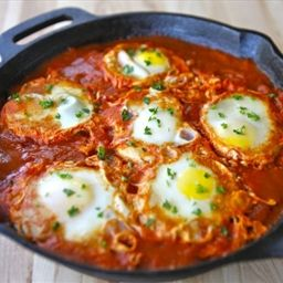 Recipe from Tori Avey: http://toriavey.com/toris-kitchen/2010/07/summer-2010-travel-blog-shakshuka/ Eggs poached in a spicy tomato and pepper sauce - Shakshuka