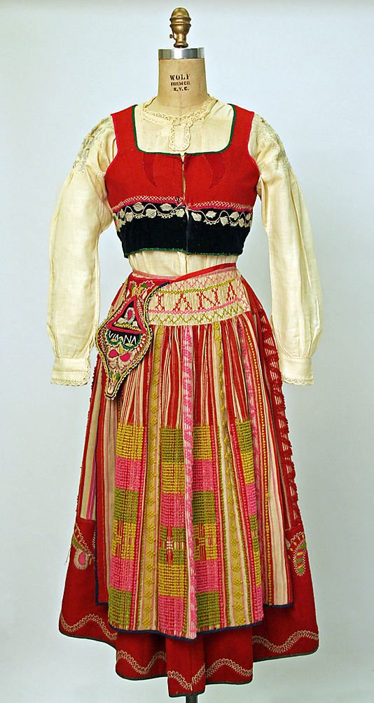 Early 20th century Portuguese ensemble. Interesting detail on the smocking and the embroidery on the apron.