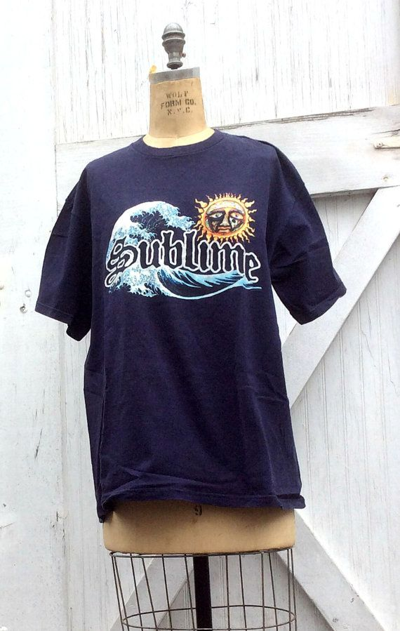 Check out this item in my Etsy shop https://www.etsy.com/listing/274855168/estate-sublime-navy-blue-t-shirt-with