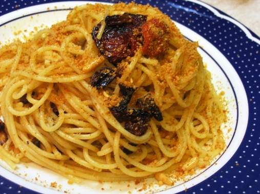 Pasta ca' muddica - Typical Sicilian dish Siracusa - Italy    Spaghetti, anchovies, raisins soaked, pine nuts, dried tomatoes in oil, garlic, olive oil, parsley, bread crumbs, salt