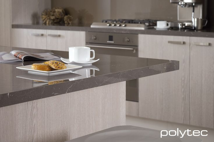 polytec bench top in LAMINATE Grigio Marble Gloss. Doors in RAVINE Drifted Oak.