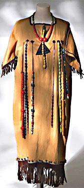 Girl's Camp Fire Ceremonial Gown and Insignia, 1920s. *This gown was worn by a girl called Sybil Vincent. Sybil and her friends from Croydon High School formed a Camp Fire group called Camp Keema, meaning 'the camp which faces the wind'. They had enjoyed reading Elsie J. Oxenham's Camp Keema series of books, which were about a group of Camp Fire girls, and wanted to use the same name.