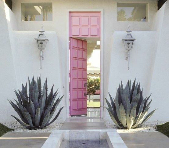 Never mind that these flanking agave plants draw blood like the spindle on Sleeping Beauty's finger--this entry way is simple and so cool!