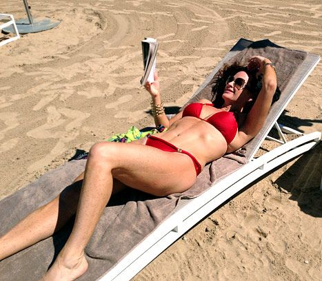 Kyle Richards lounges in a red bikini in Puerto Rico.