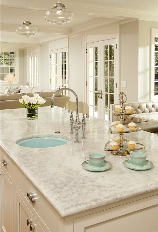 Love the bright neutral kitchen with the BLUE sink...love love love. Looks so clean!
