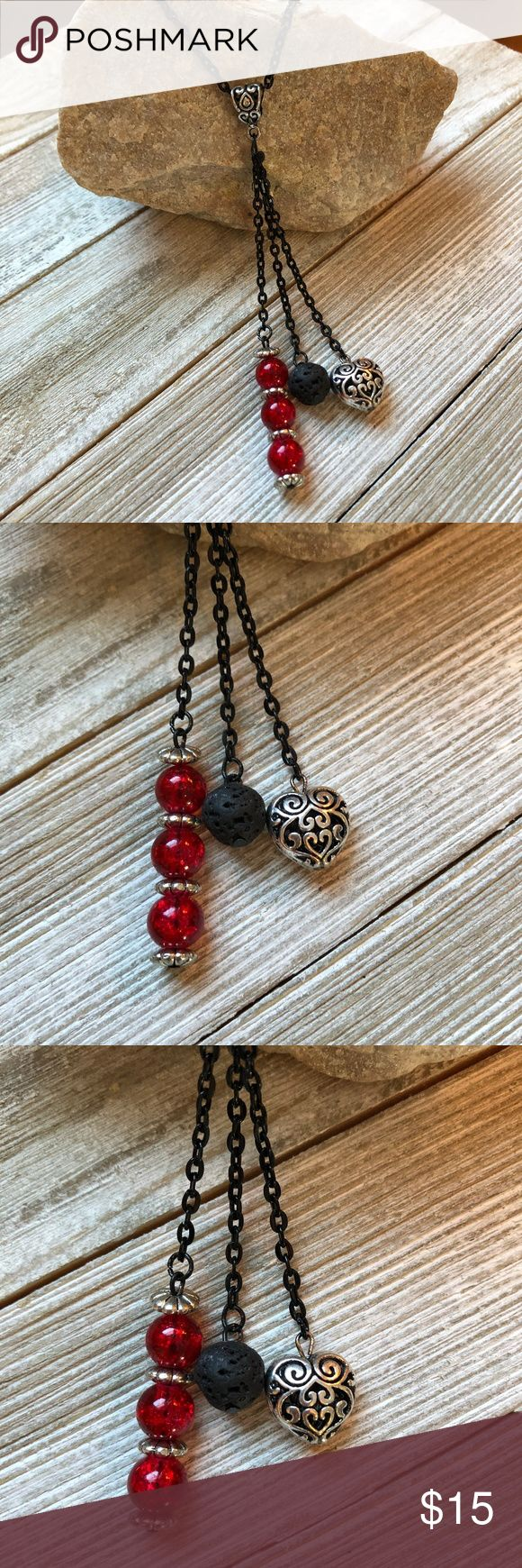 Essential Oil diffuser Necklace glass lava rock 22 inch black chain with 2 inch dangles.  Red Glass Beads, Lava rock bead and metal filigree heart.  Put essential oil on lava rock bead to carry aroma with you!  Essential oils available on my website shown in banner at top of my closet, click it to go to my site. Lisa Halstead Jewelry Necklaces