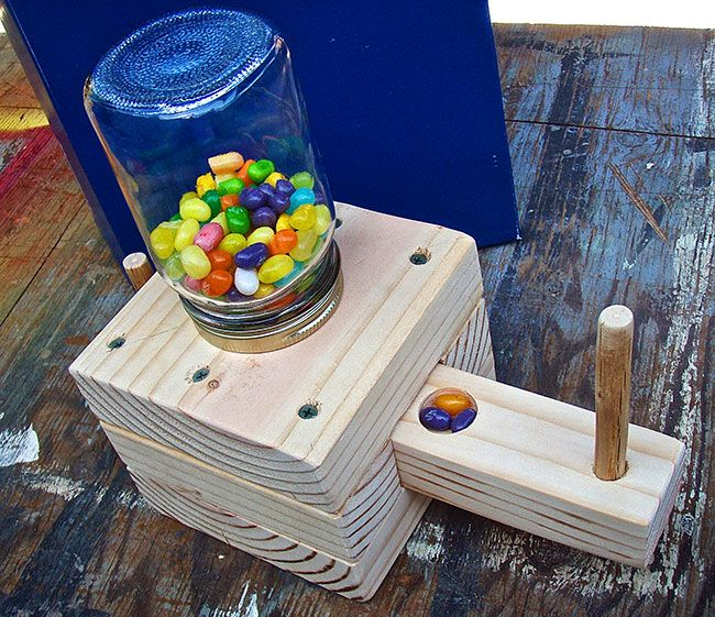 You can make this fun wooden dispenser for jelly beans ...