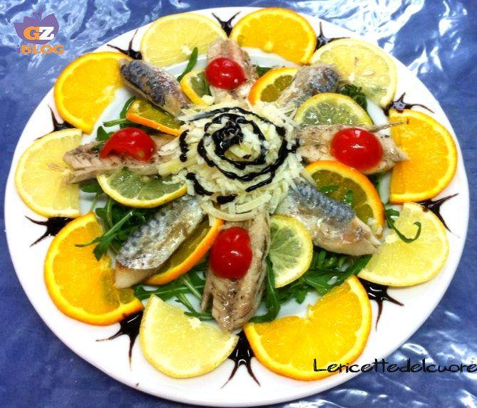 Insalata di sgombri con arance scaglie di parmigiano e pomodorini, una ricetta semplice ma davvero particolare e fresco, un secondo o un antipasto ottimo