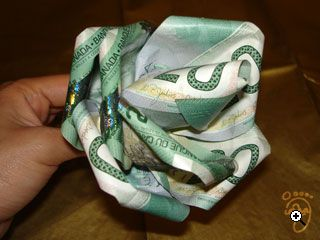 I made a large money bouquet for @Jessica Blackwood's Sweet 16....this is very time consuming...but worth it :)